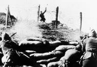 Asisbiz Insurgent fighter tosses a hand grenade at loyalist soldiers Burgos Spain Sep 12 1936 01