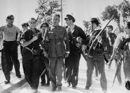 Asisbiz Spanish rebel who surrendered is lead away after summary court martial by civil guards Madrid Spain July 27 1936 01
