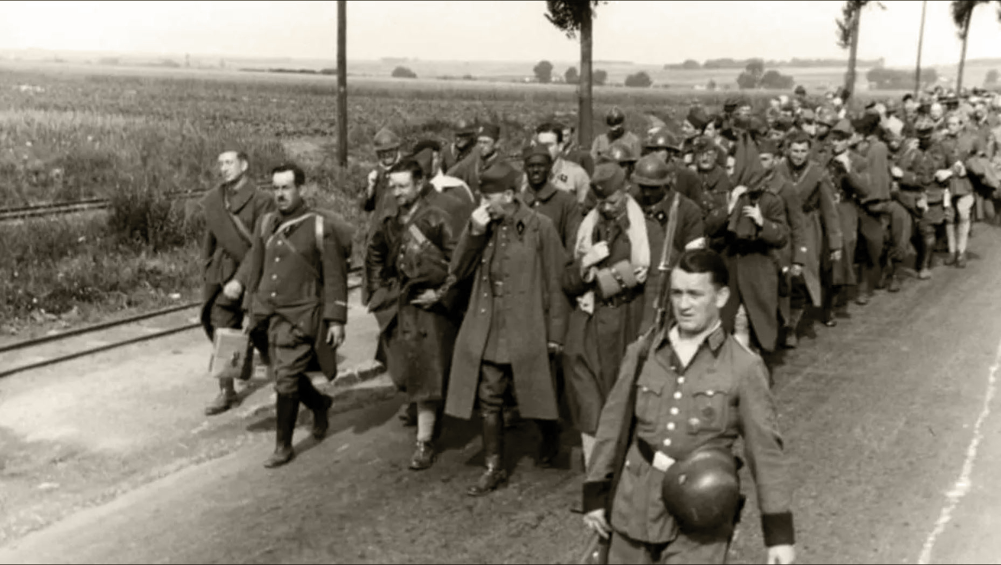 Column of French POWs being marched towards internment June 1940 03
