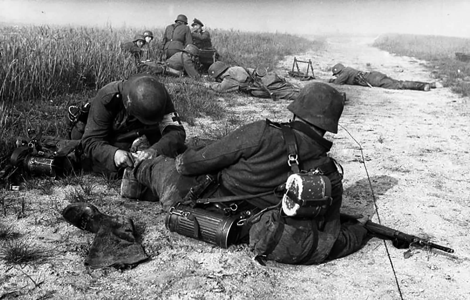 German military medic providing first aid to a fellow wounded soldier 1940 wiki 01