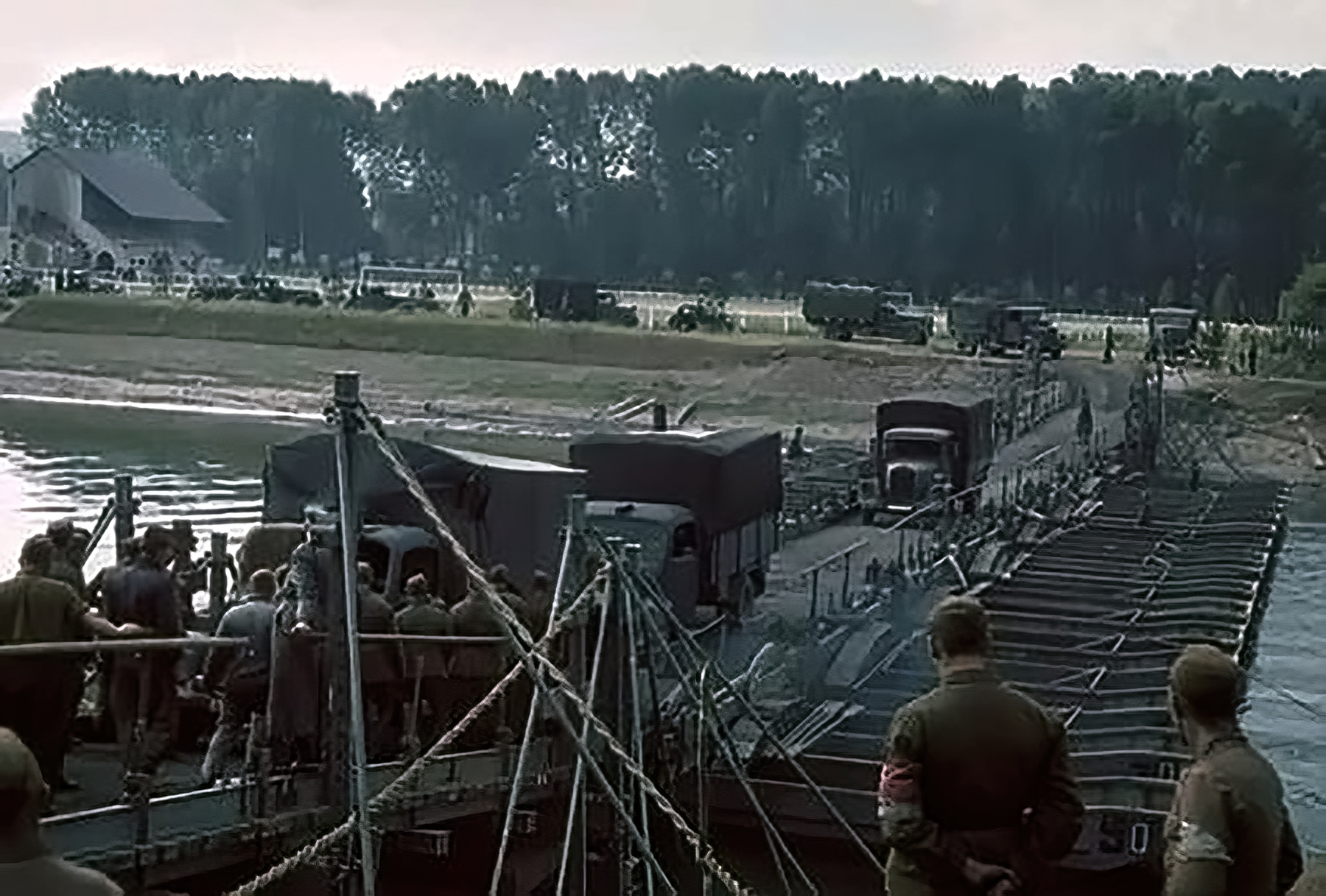 German troops cross a pontoon bridge on their way to Paris after Frances capitulation 25th June 1940 01