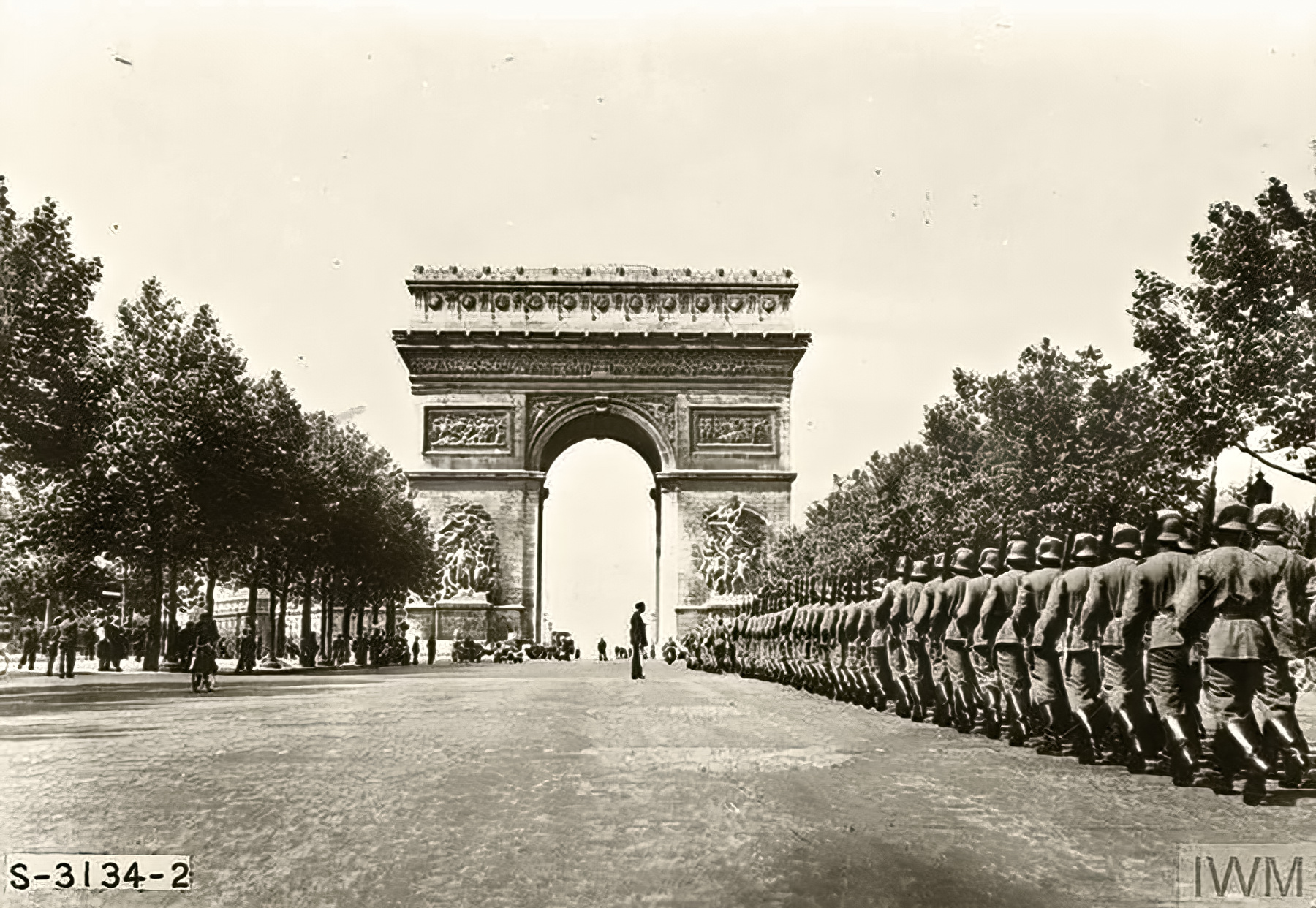 German troops during their victory parade march under the Arc de Triomphe France 1940 IWM