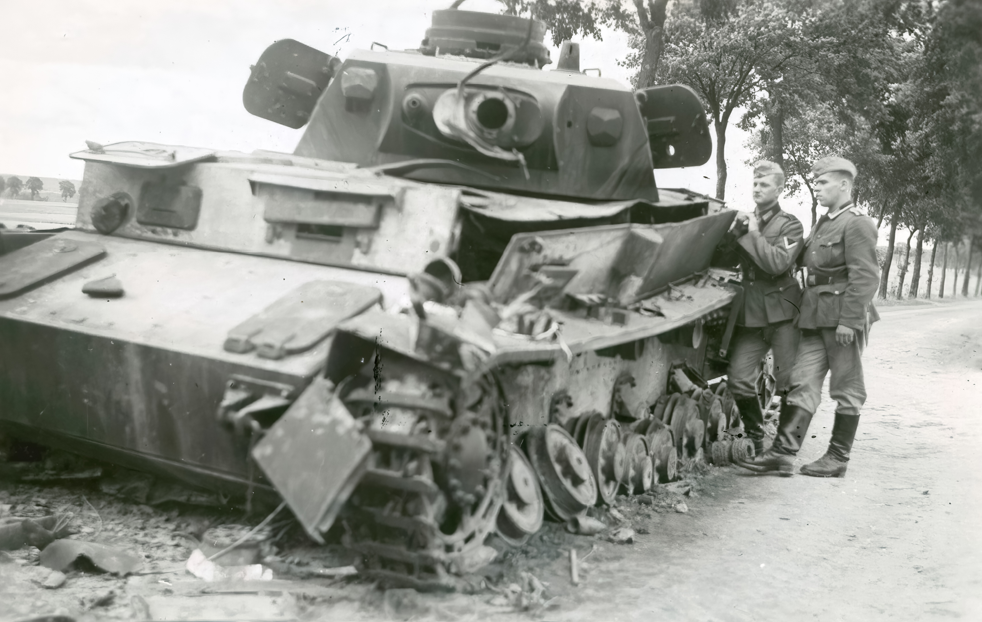 Wehrmacht Panzer III tank knocked out on the road to Amiens 1940 NIOD