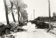 Asisbiz Dunkirk roads littered with destroyed vehicles after the BEF withdrawal from France 12th Jun 1940 01