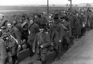 Asisbiz French POWs prisoners of war are marched into internment wiki 01