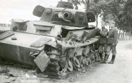 Asisbiz Wehrmacht Panzer III tank knocked out on the road to Amiens 1940 NIOD
