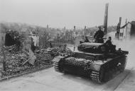 Asisbiz Wehrmacht Panzer III tanks drive through a bombed out town France 21st Jun 1940 NIOD