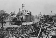 Asisbiz Wehrmacht tank passes a downed French bomber La Vallee France 2nd Jun 1940 NIOD