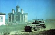 Asisbiz German Motorized Troops in a Sdkfz 250 pass through a deserted Russian village 01