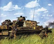 Asisbiz German Panzer PzKpfw III tank red 633 supported by German Infranty advances slowly forward 01