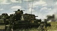 Asisbiz German Panzer PzKpfw III tank red 633 supported by German Infranty advances slowly forward 02