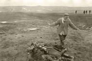 Asisbiz German atrocities Grief striken father cant beleive the sight of his murdered family by German soldiers 01