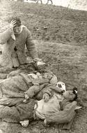 Asisbiz German atrocities Grief striken father cant beleive the sight of his murdered family by German soldiers 03