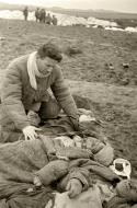 Asisbiz German atrocities Grief striken father cant beleive the sight of his murdered family by German soldiers 04
