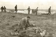 Asisbiz German atrocities Grief striken father cant beleive the sight of his murdered family by German soldiers 05