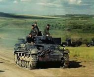 Asisbiz German column of trucks and Panzer PzKpfw IVs advancing into Russia 1941 01