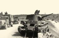 Asisbiz Soviet BT 7 light tank being salvaged after a battle with German forces 01