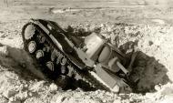 Asisbiz Soviet KV 1 heavy tank lies abandoned in a ditch after a stuka attack 1941