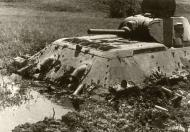 Asisbiz Soviet T 34 tank abandoned after becoming bogged is inspected by German forces 02