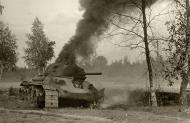 Asisbiz Soviet T 34 tank detroyed after a battle with German forces 03