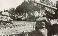 Soviet T 34 tanks including a British Valentine lie abandoned after battling German forces Rzhev 1942