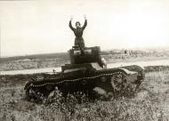 Asisbiz The commander of a T 26 light tank surrenders to the command Hande hoch 01