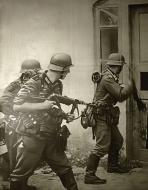 Asisbiz What all off occupied Europe use to fear German Forces pounding at the door 01