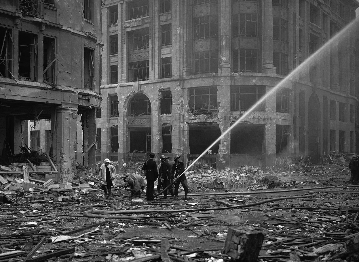 Asisbiz battle of britain firemen spray water on damaged for How many homes were destroyed in germany in ww2