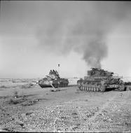 Asisbiz British Crusader tank passes a burning German PzKpfw IV tank 27 Nov 1941 IWM E6752