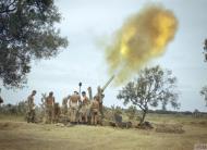 Asisbiz British desert forces 4.5 inch gun fires on a target Tunisia IWM TR1004