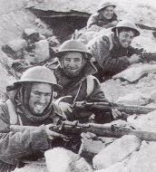 Asisbiz British infantry soldiers laughing as they wear their winter woolens in a desert North Africa 01