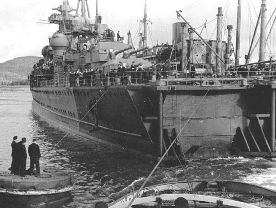 Kriegsmarine Cruiser KMS Prinz Eugen Moored alongside repair vessel Huscaran 01