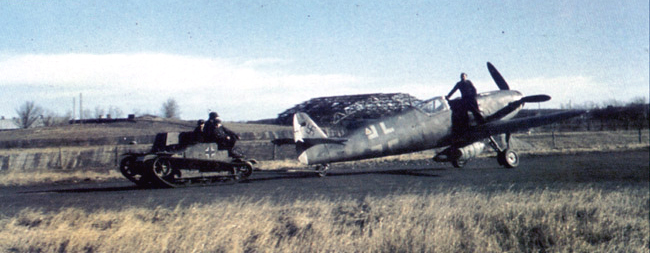 Bf 109G14 being towed towards the runway area Germany 1945 01