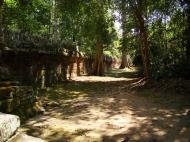 Asisbiz A Banteay Kdei Temple Gopura IV E Bayon style laterite walls 03