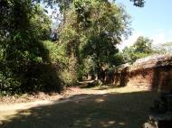 Asisbiz A Banteay Kdei Temple Gopura IV E Bayon style laterite walls 04