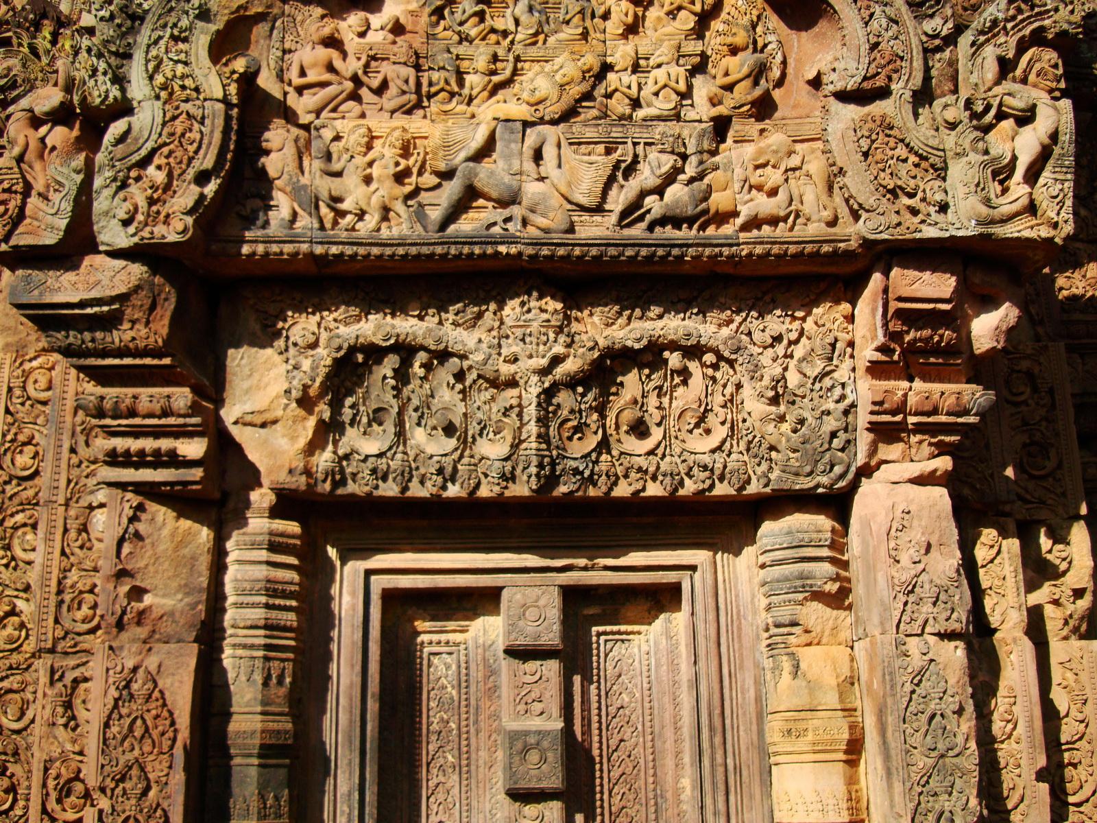 Banteay Srei red sandstone pediment shows Ravana shaking Mount Kailasa 03