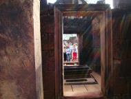 Asisbiz Banteay Srei Hindu Temple red sandstone carved passages 06