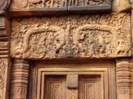 Asisbiz Banteay Srei Temple pediment closeups burning of Khandava Forest 02