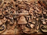 Asisbiz Banteay Srei red sandstone pediment shows Narasimha clawing Hiranyakasipu 01
