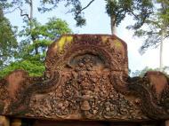 Asisbiz Banteay Srei red sandstone pediment shows Narasimha clawing Hiranyakasipu 02