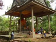 Asisbiz Baphuon temple external Buddha 02