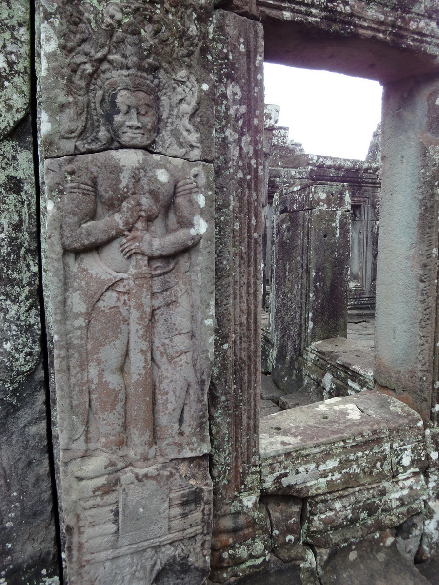 Bayon Temple Bas relief mythic guardians Asuras stand on guard 01