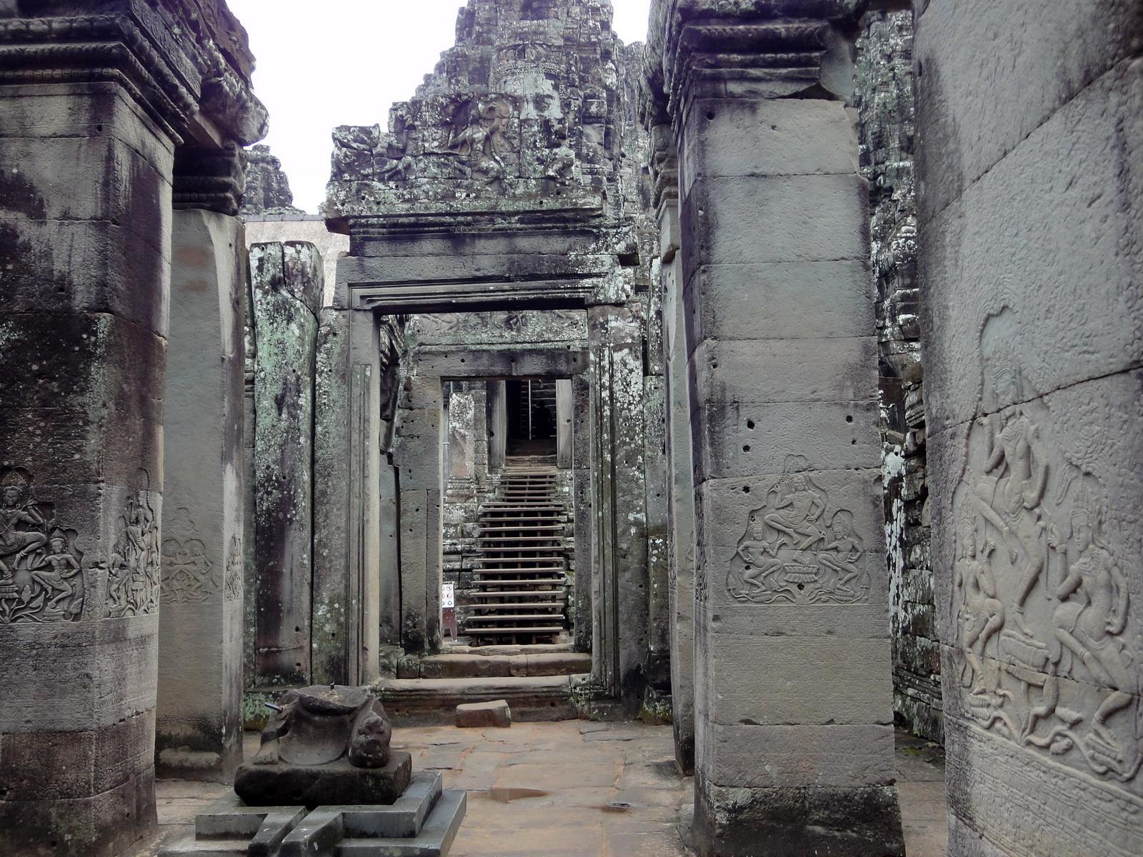Bayon Temple Bas relief pillars three dancing apsaras Angkor 16