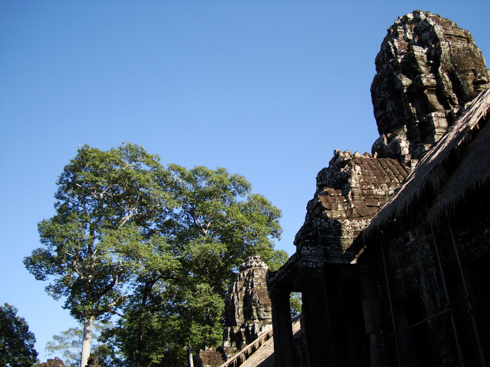 Bayon Temple SW corner inner gallery face tower Angkor Siem Reap 01