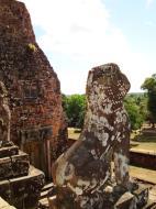 Asisbiz Facing SE Pre Rup Temple upper courtyard lions East Baray 01