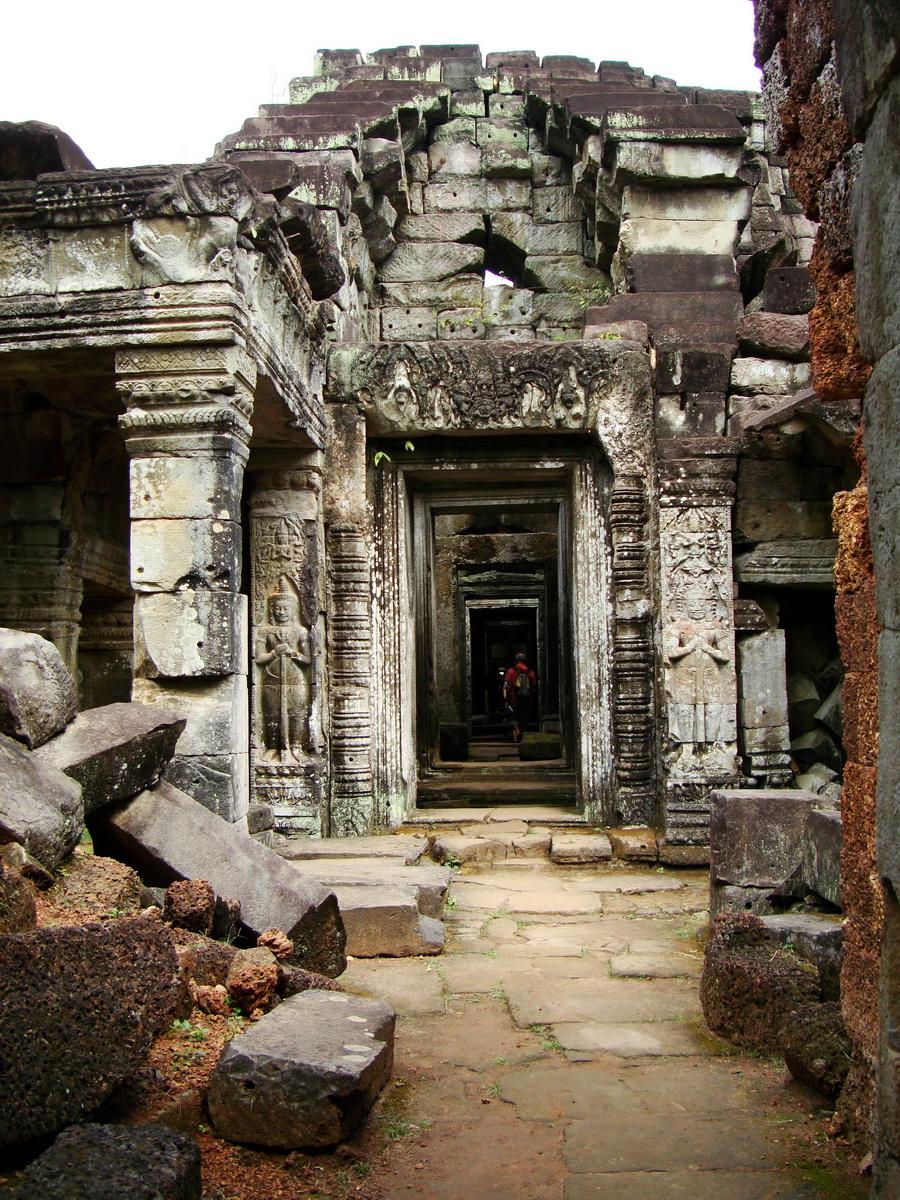 Preah Khan Bas relief mythic guardians Asuras Dvarapalas stand ready 01
