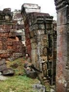 Asisbiz Preah Khan Bas relief mythic guardians Dvarapalas stand on guard 05