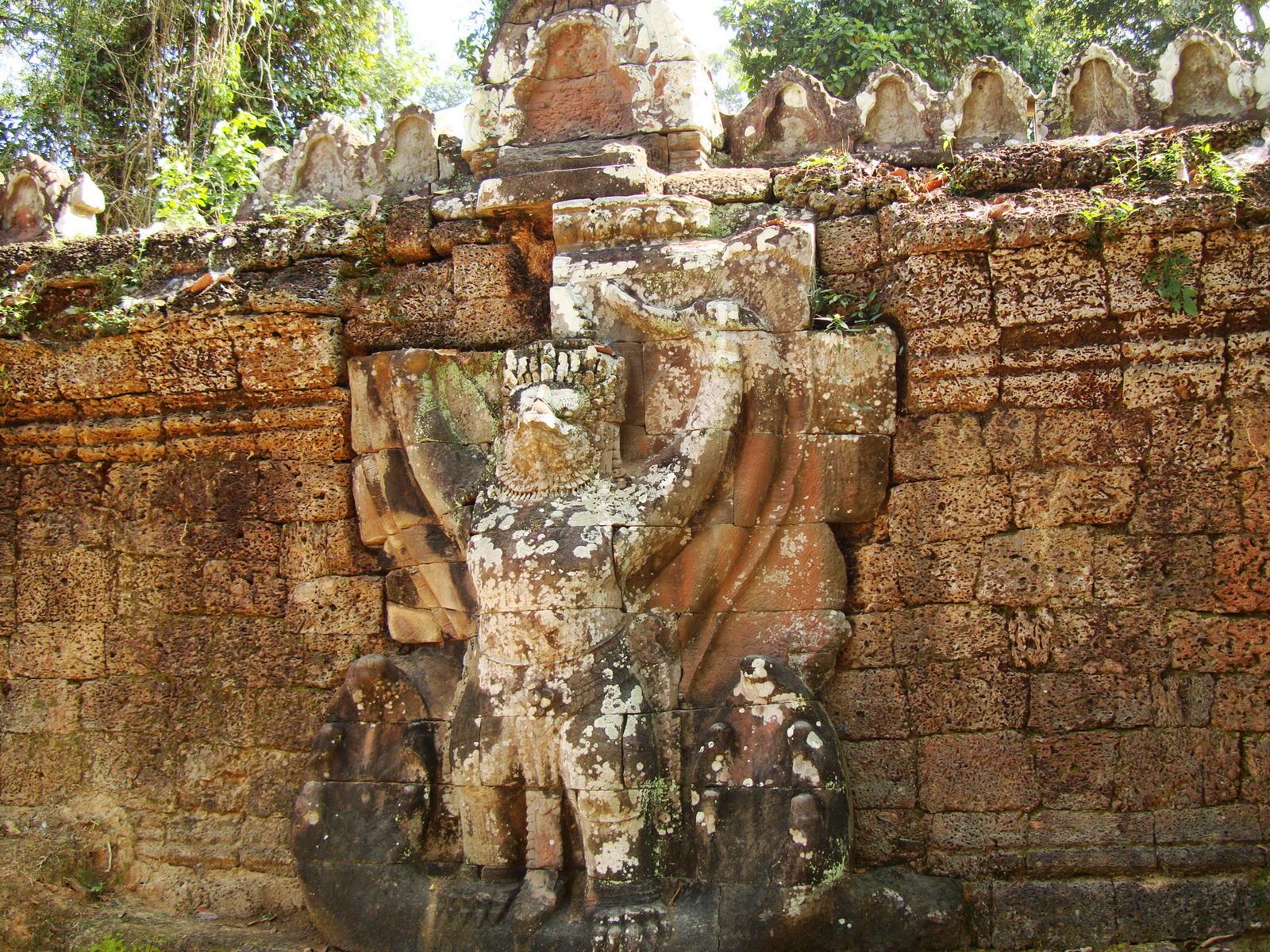 Preah Khan Temple 4th wall enclosure 5m Garuda holding Nagas 04
