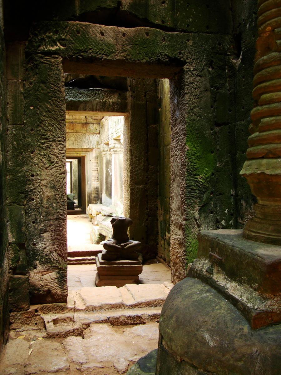 Preah Khan sanctuary headless Buddha and stupa Preah Vihear province 05