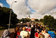 Asisbiz Tallinn hop on hop off bus city tour background St Olafs Church viewed from Mere puiestee Tallinn 01